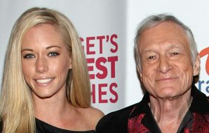 """LOS ANGELES, CA - MARCH 10: Playboy Playmates Kendra Wilkinson (L) and Bridget Marquardt pose with Hugh Hefner at the premiere of The Travel Channel's """"Bridget's Sexiest Beaches"""" held at the Playboy Mansion on March 10, 2009 in Los Angeles, California. (Photo by Alberto E. Rodriguez/Getty Images)"""